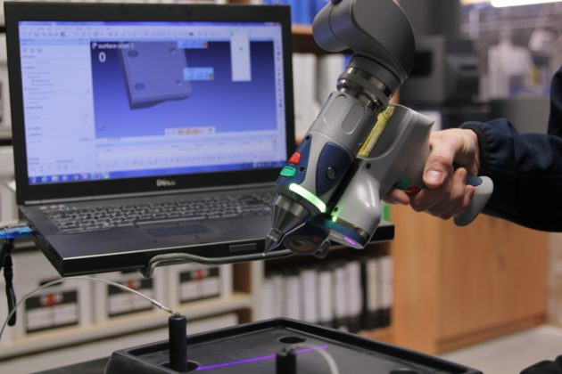 3D Scan arm being used to measure a part